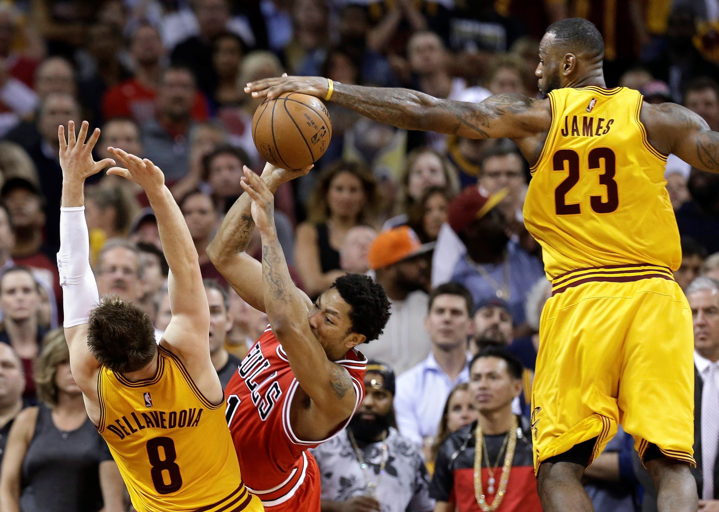 Cleveland Cavaliers forward LeBron James blocks a shot by