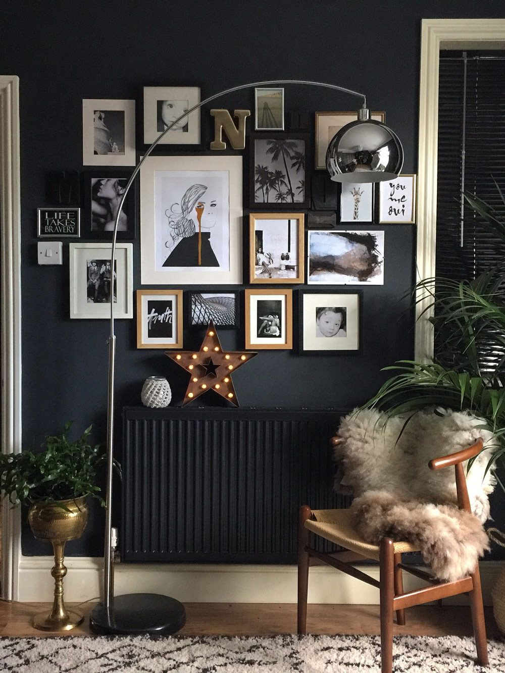 *especially love the dark walls* With historic details as the backdrop of their art-filled home, Nadia and Mark Singleton live in a 1,500-square-foot dwelling in Leicestershire, England.