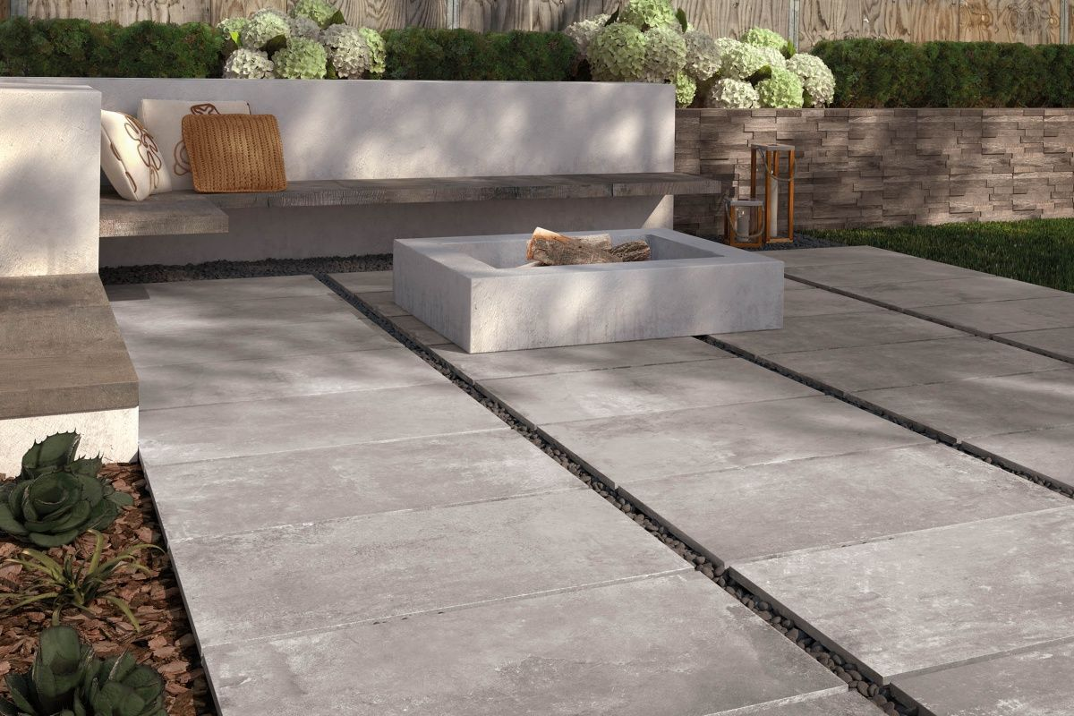 A Fire Pit Setup Using Oversized Outdoor Porcelain Tiles By Supergres Outdoor Porcelain Tile Patio Tiles Outdoor Tiles
