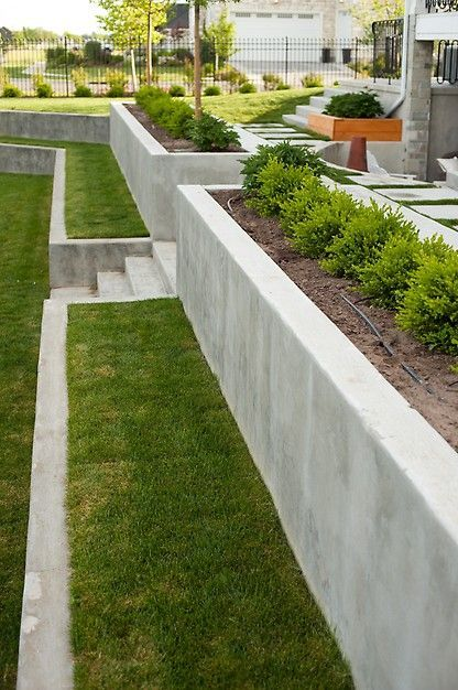 Photo of Raised bed with astro lawn forms a beautiful soft surface on which you can still sit …