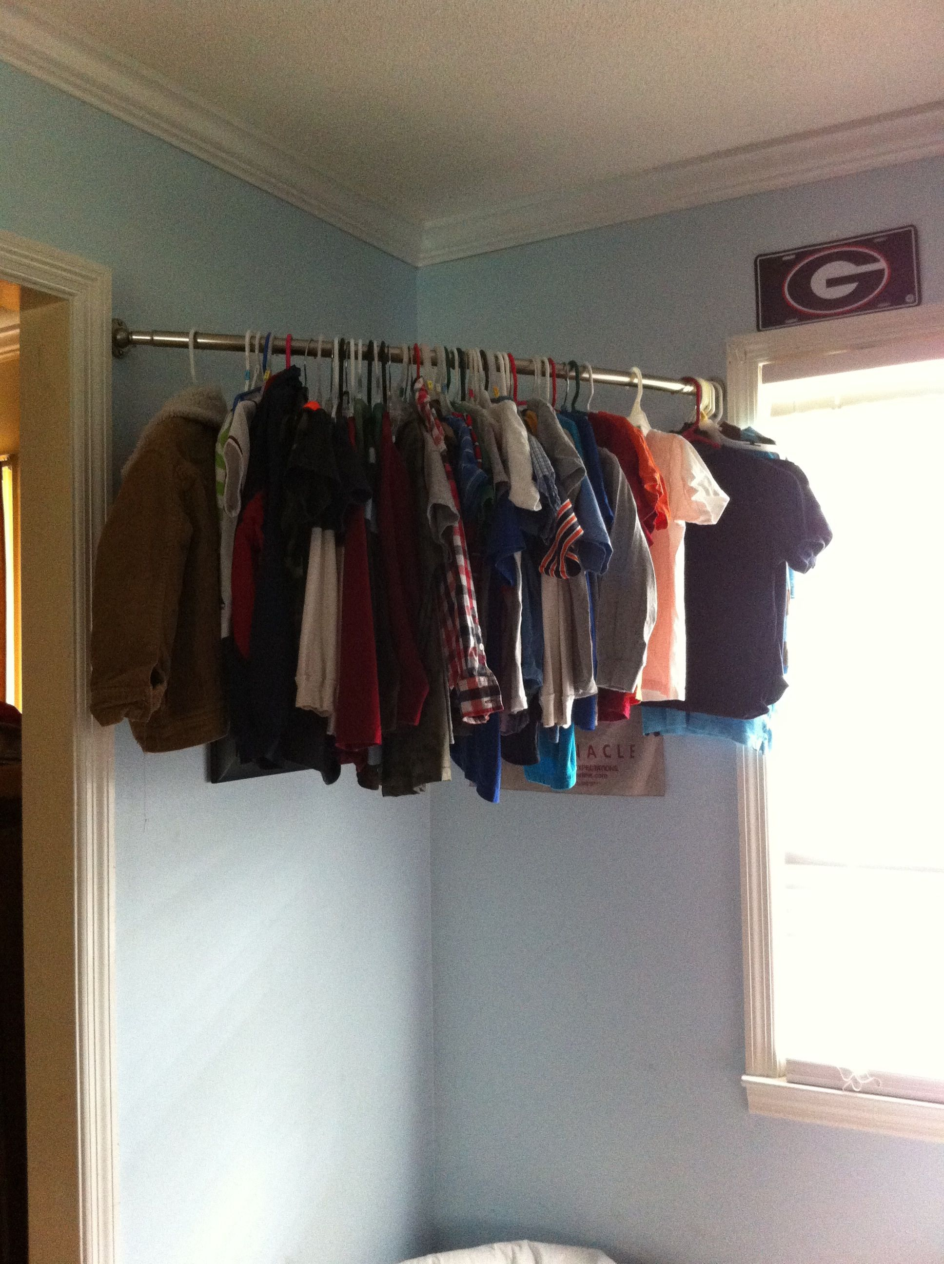 No closet i used a curved shower rod for my son 39 s clothes No closet hanging solutions