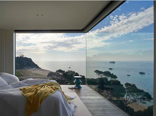 Huge Windows With Stunning Ocean View In A Contemporary Bedroom