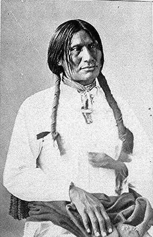 Big Foot (Sitanka), a Miniconjou Sioux of Cheyenne River Reservation, South Dakota; half-length, seated, wearing white shirt.