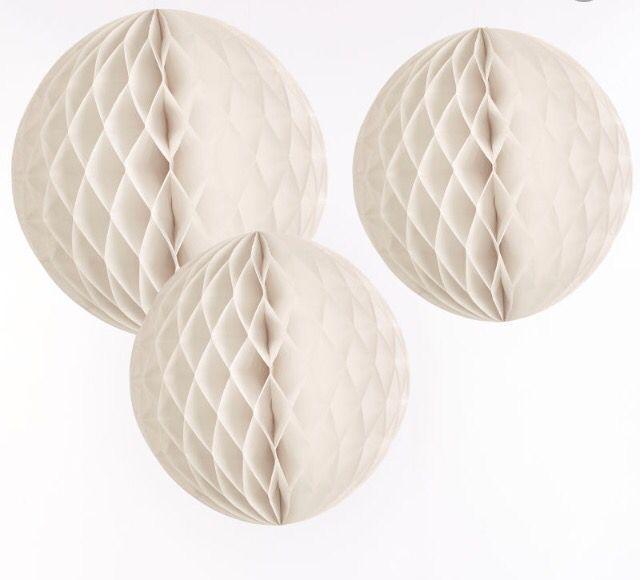 Tissue balls to compete paper chain garlands above bar