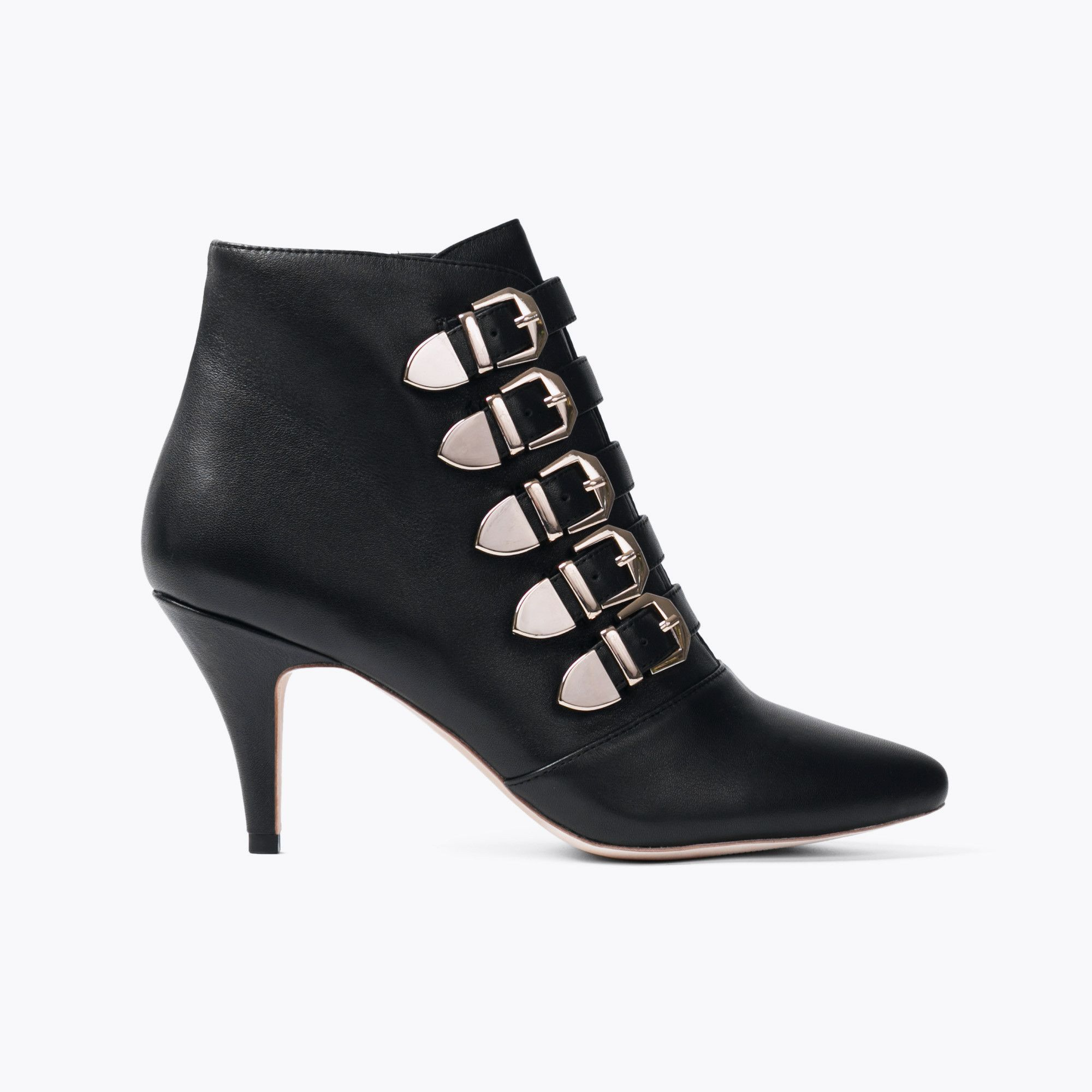 2ad8eadf3ef2 Strap is a biker-inspired ankle boot designed in butter soft black leather  with a sleek pointed silhouette. The buckle strap and studs combine for a  ...