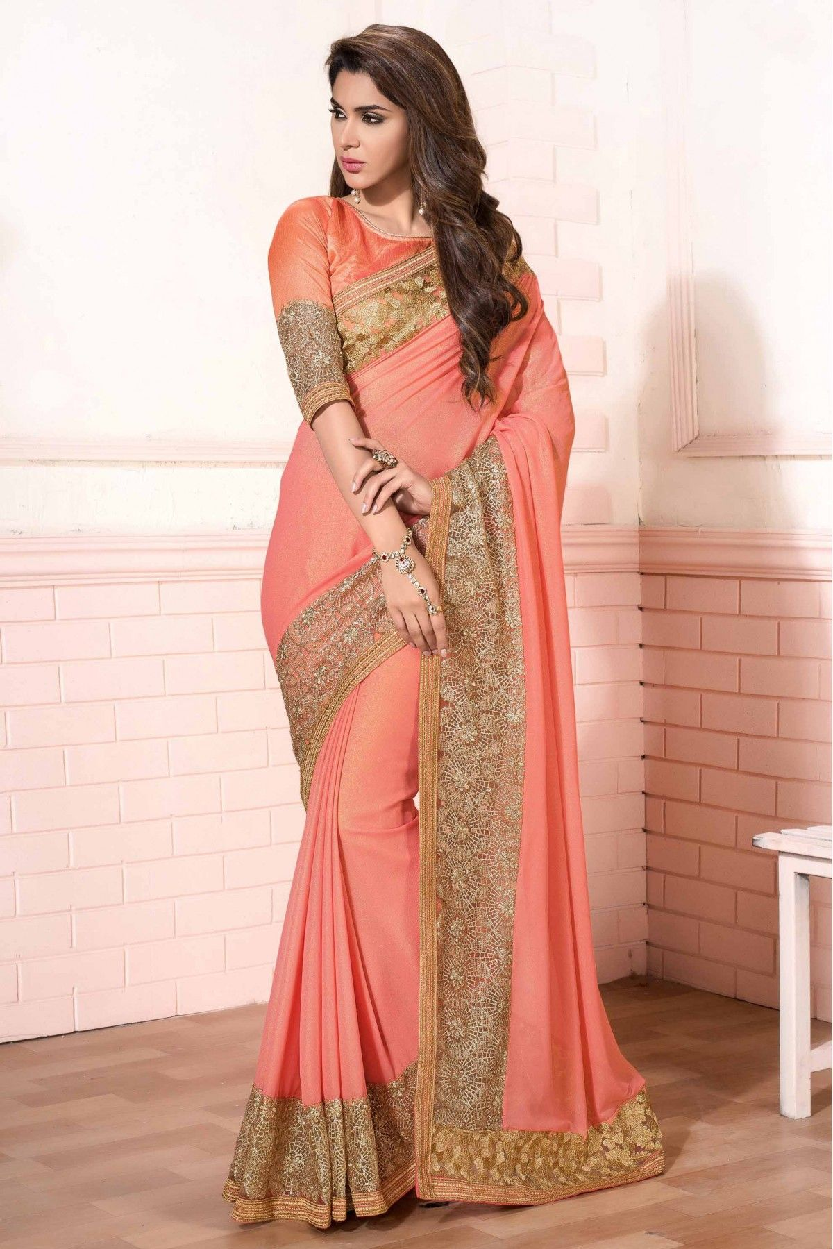 a5daa8b76e Georgette Designer Saree in Peach Colour.It comes with matching Blouse.It  is crafted with Lace Work,Embroidery Design.