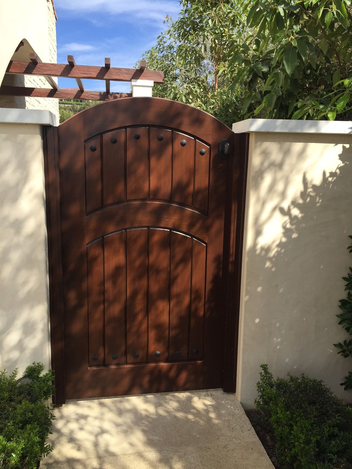 Custom Wood Gate By Garden Passages With Arched Crossbar
