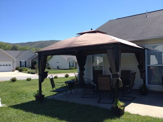 Gazebo With Planters Anchoring The Legs For The Home