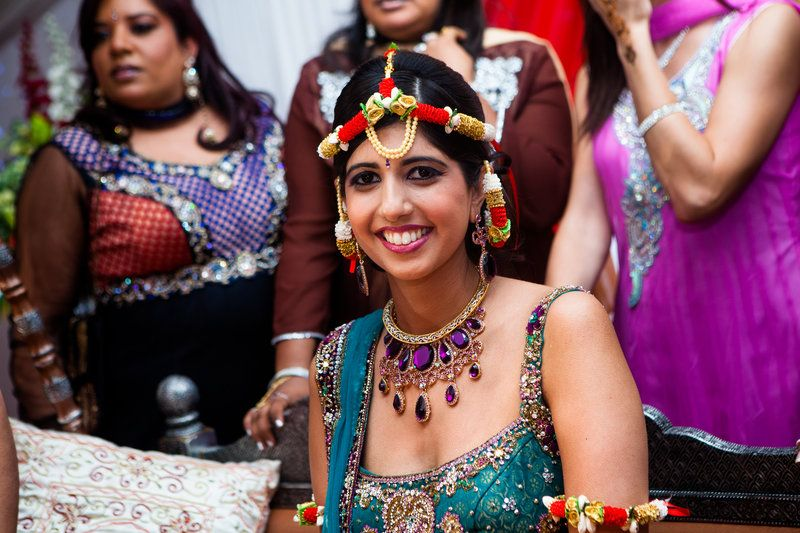 The beautiful bride celebrating at her Mehndi ceremony at