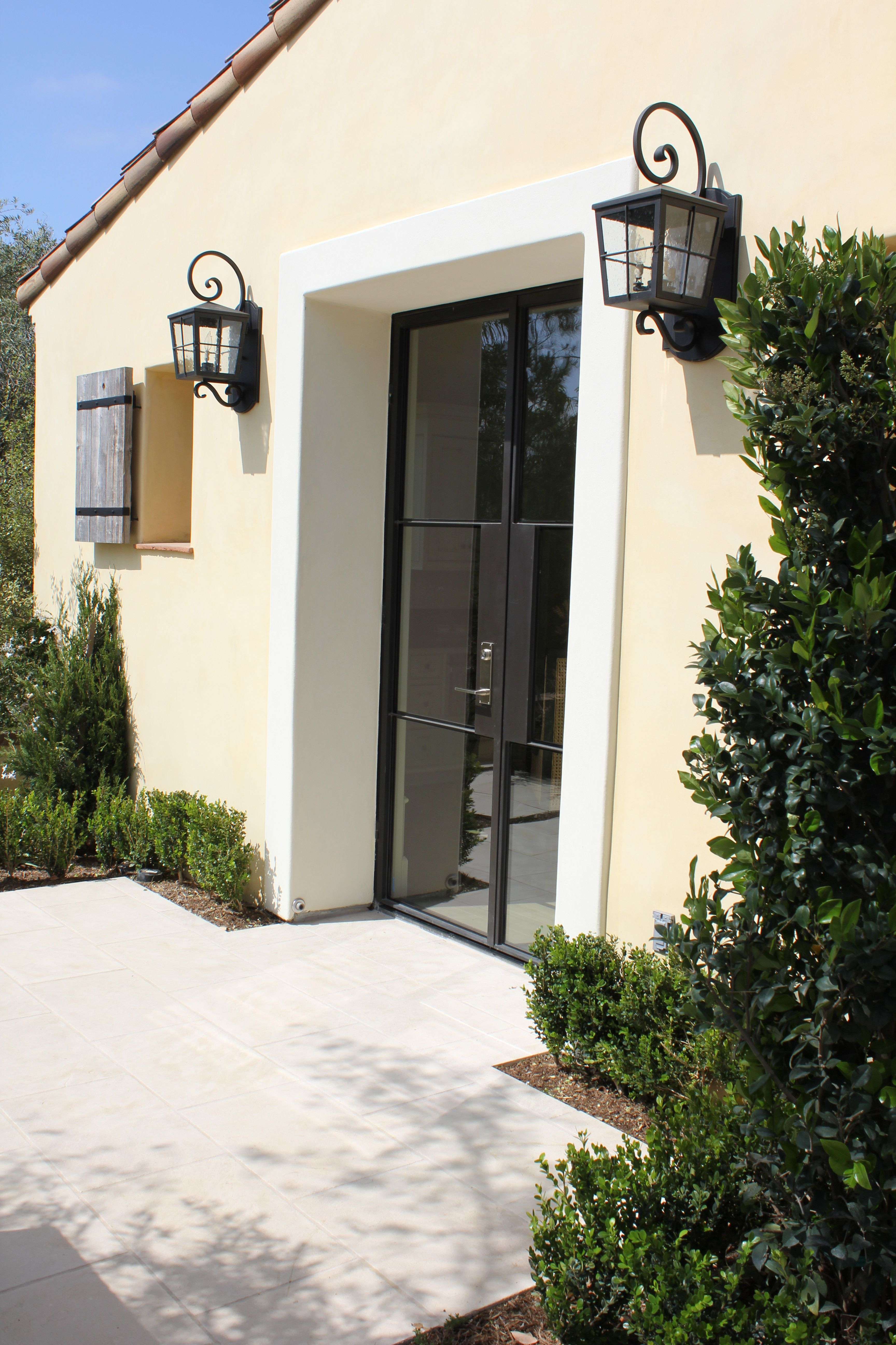 Shady Canyon Ca Santa Barbara Smooth Finish Butter Yellow White Trim Sanded Wood Patio Iron Gates Stucco Homes House Exterior Contemporary House Exterior