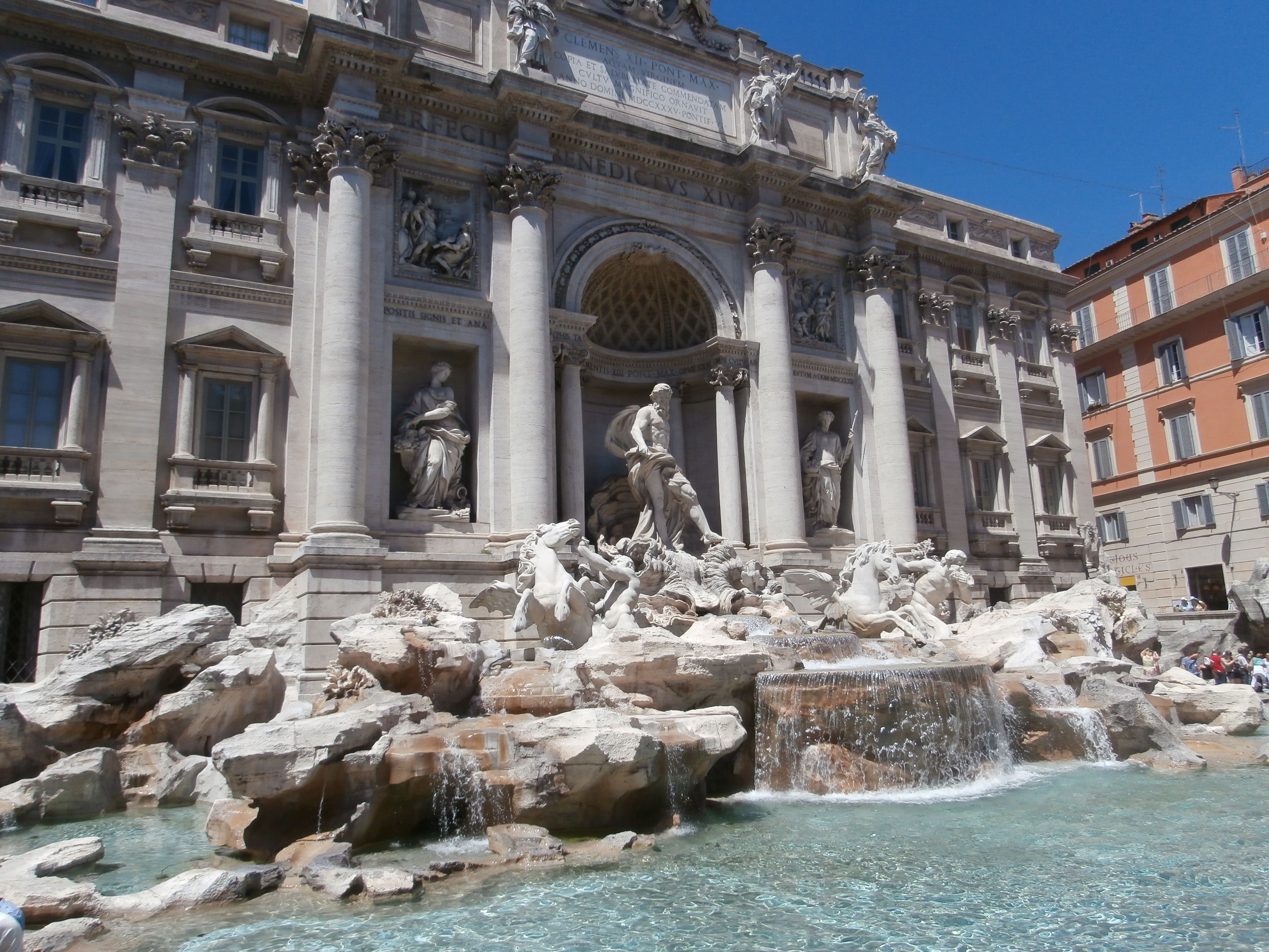 Trevi fountain Rome, this is where I got engaged.  Where the person in the red shirt is sitting is the corner where Jens purposed