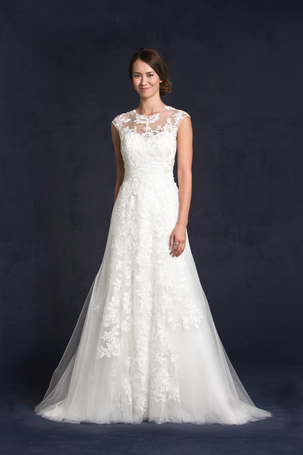 #Germaine from our 2015 Collection shows-off delicate soft lace and tulle.  Not only does she have an illusion neckline, the back is just as stunning.  To see more of our #Germaine gown, check out our website www.lissimon.com.