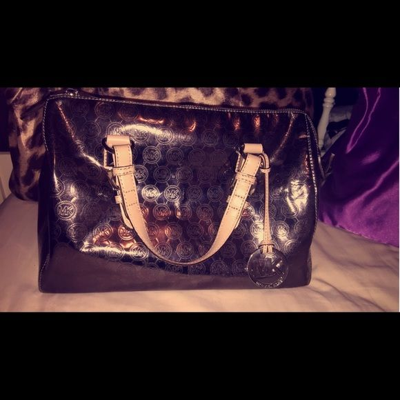 MK barrel purse. Only carried a couple times. New condition. Metallic sliver. PRICE CAN BE NEGOTIATED. Michael Kors Bags