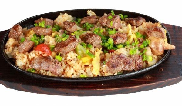 Рецепта за Свински пържоли с ориз на фурна