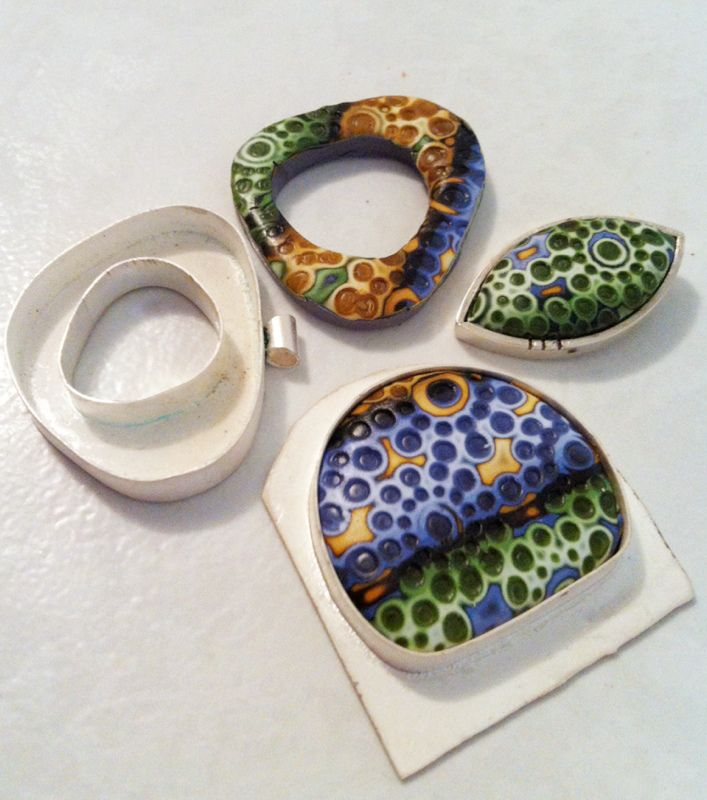 Pieces in progress that use one of her skinner blend jelly roll mokume gane sheets. I love the design she pressed in, too. Concentric rings of dots / bubbles. Inspiration!