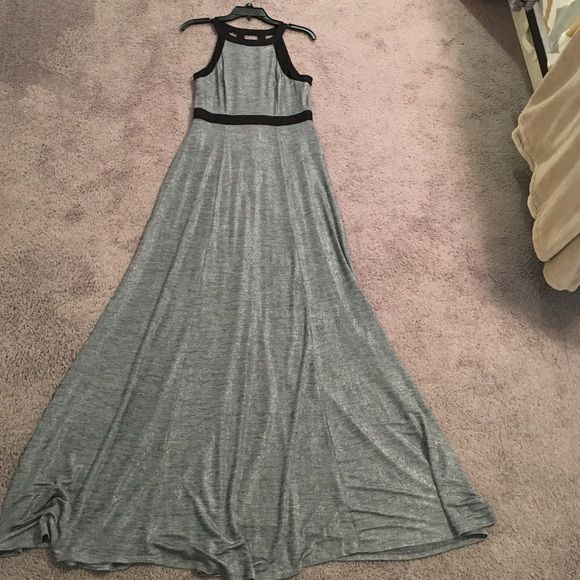 BCBGeneration Silver and Black Maxi Dress Gown NWT BCBGeneration Silver and Black Maxi Dress Gown in size medium. I am 5'6 and would need to wear 3 to 4 inch heels to keep from tripping on the dress. Beautiful open back. BCBGeneration Dresses Prom