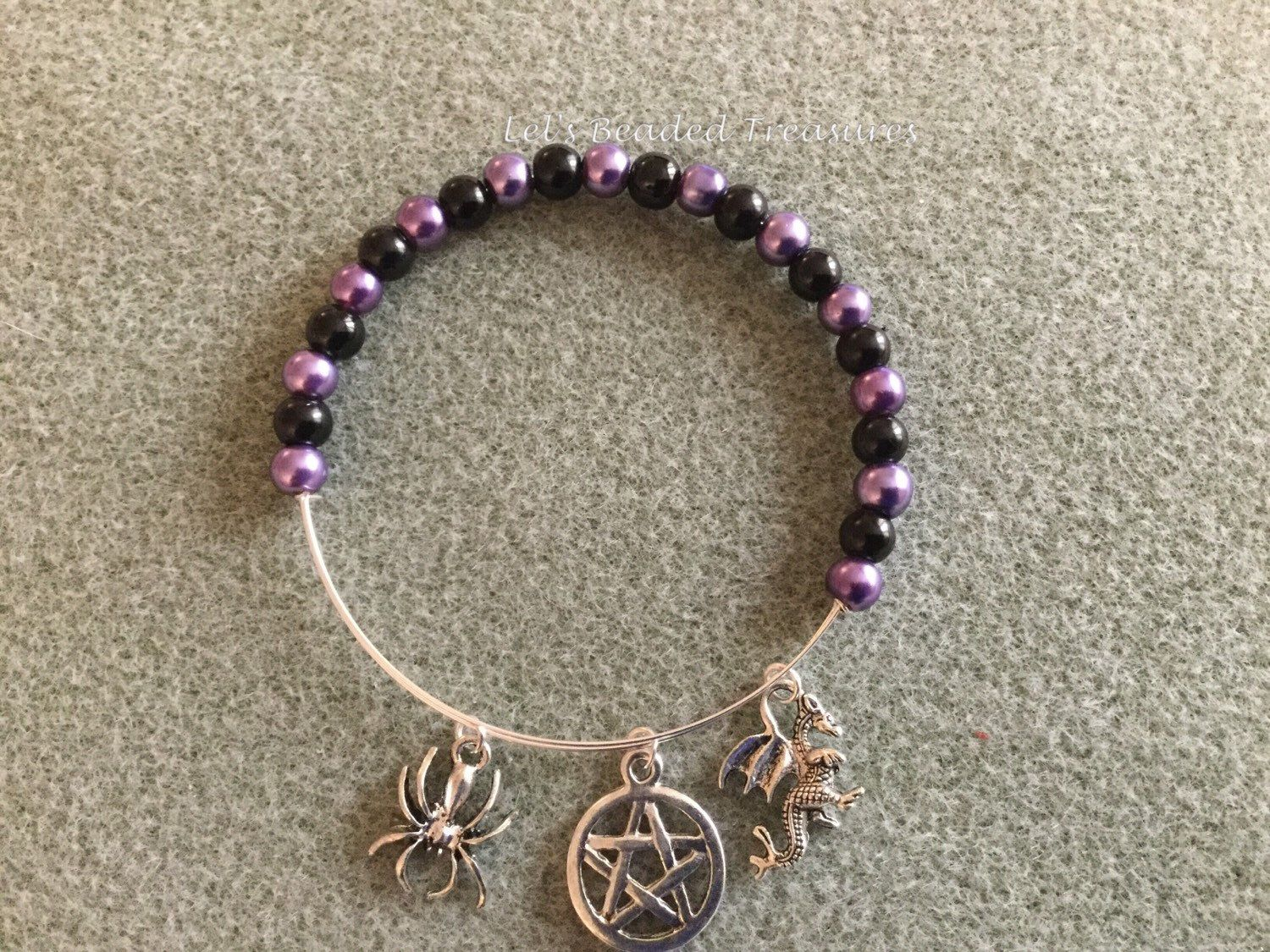 A personal favourite from my Etsy shop https://www.etsy.com/uk/listing/277298258/purple-and-black-pagan-theme-expanding