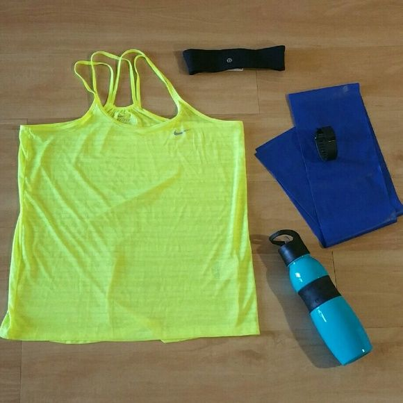 """NIKE Womens Neon Yellow Athletic Top Pullover athletic attire top Dri-Fit. Has some stretch. Small string pull on the front. Barely noticeable! (shown in picture) In excellent condition with no stains or tears noted!  Please note: Only item described in listing included. Other items appearing in picture for decorative purpose only From a pet & smoke free home!  Fabric:   100% Polyester Measurements (approx):  length 24"""" pit-to-pit 18"""" waist 36"""" Nike Tops Tank Tops"""