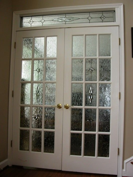 Double 15 Light Rasied Grid Doors With Krinkel Glass On Preimeter 7 Part Clear Bevel In Center With Tulip Accents Top And Bottom