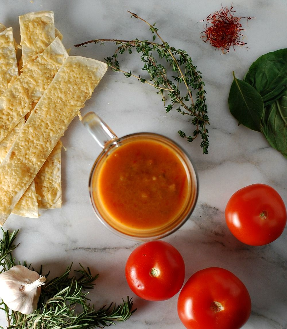 Saffron and Roasted Tomato Soup with Parmesan Crisps http://www.foodandflight.com/recipe-items/saffron-and-roasted-tomato-soup/