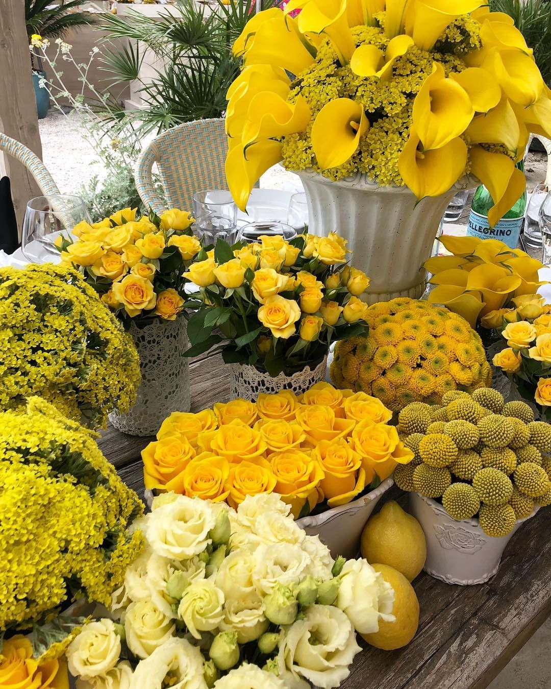 A Few Yellow Fleurs On Simple Beachside Tables And By A Few Yellow