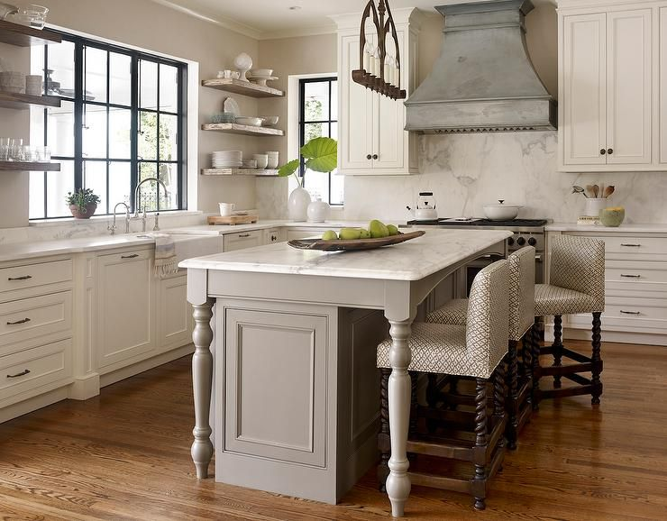 Transitional Kitchen Features An Iron Linear Chandelier