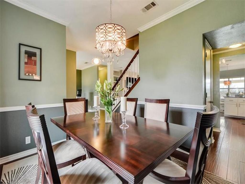 Beautiful dining room with hardwood floors and unique lighting fixture 10600 Leafwood Ln, Austin, TX 78750