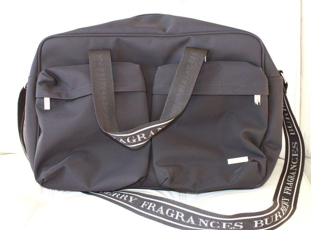 Estee Lauder Small Barrel shaped Navy patterned bag New