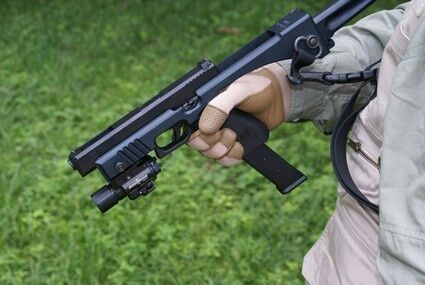 Glock with a foldable handguard and a extended magazine, along with a underbarrel light. One should consider it for the glock 18 due to the recoil it produces..