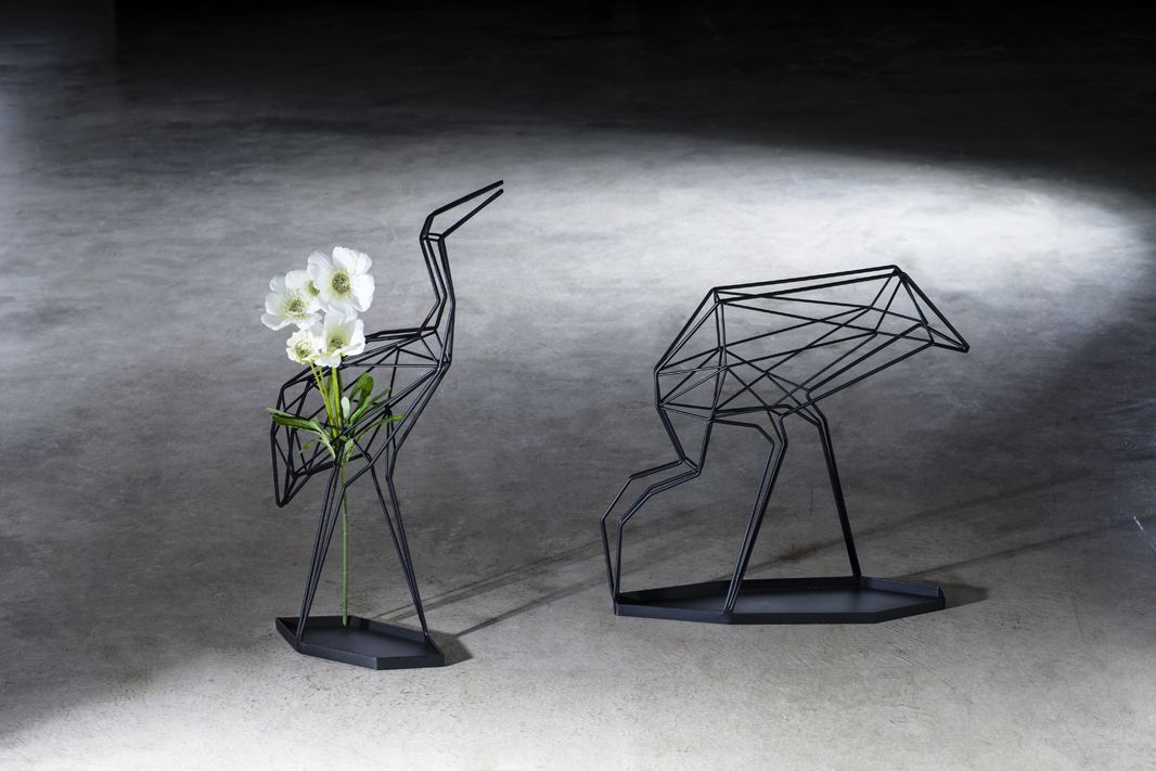"""""""Crane"""" Made with twisted wires, the crane features a visual compound of virtuality and reality. Its lifelike silhouette presents different looks when seen from different angles.  http://www.libertedesign.tw/"""