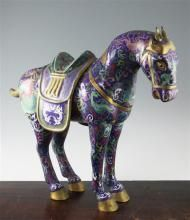 A Chinese cloisonne enamel model of a saddled horse, 18in.