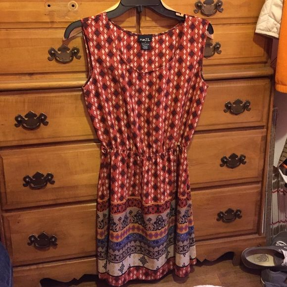 Rust colored dress! The main color of the dress is a rust color. There is also tan, brown, and a few other colors on it! It's a great fall piece to have in your closet! Rue 21 Dresses Midi