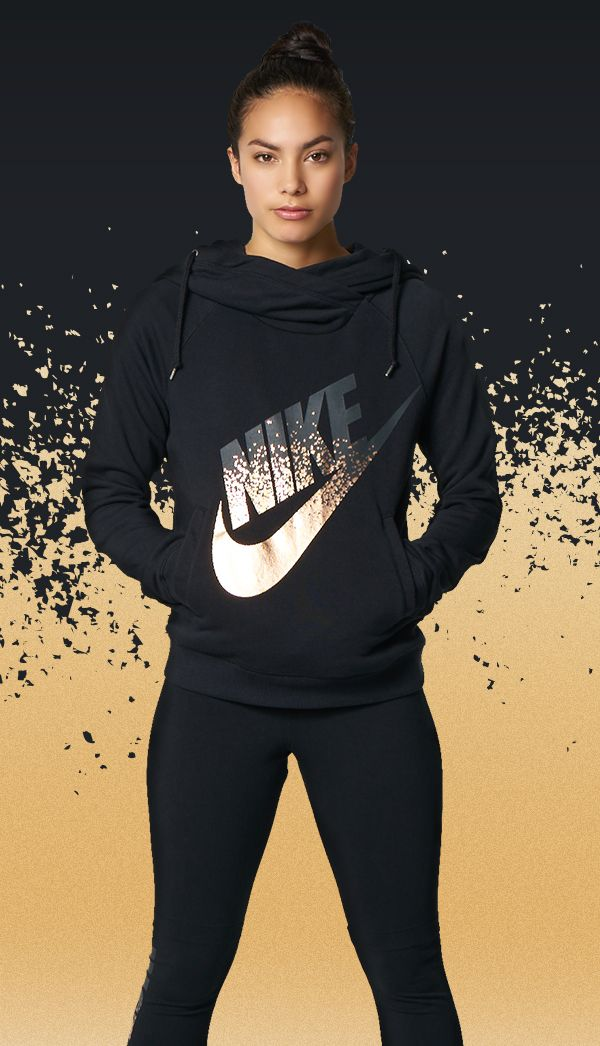eb98629b4 The iconic Nike swoosh gets a bright new look on the Nike Rally Metallic  Funnel Neck Pullover hoodie. Sport layers of brand new Nike Prints made ...