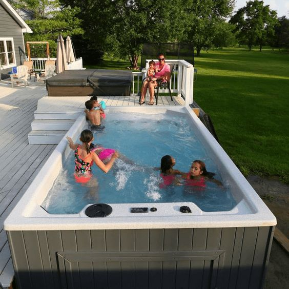Royal Swim Spa is part of Hot tub swim spa, Swim spa landscaping, Swimming pools backyard, Swim spa, Swim spa deck, Swimming pool spa - Everything that makes our hot tubs great has been incorporated into our Royal Spa Swim Spa  Perfect for swim workouts  Can be used as a giant hot tub