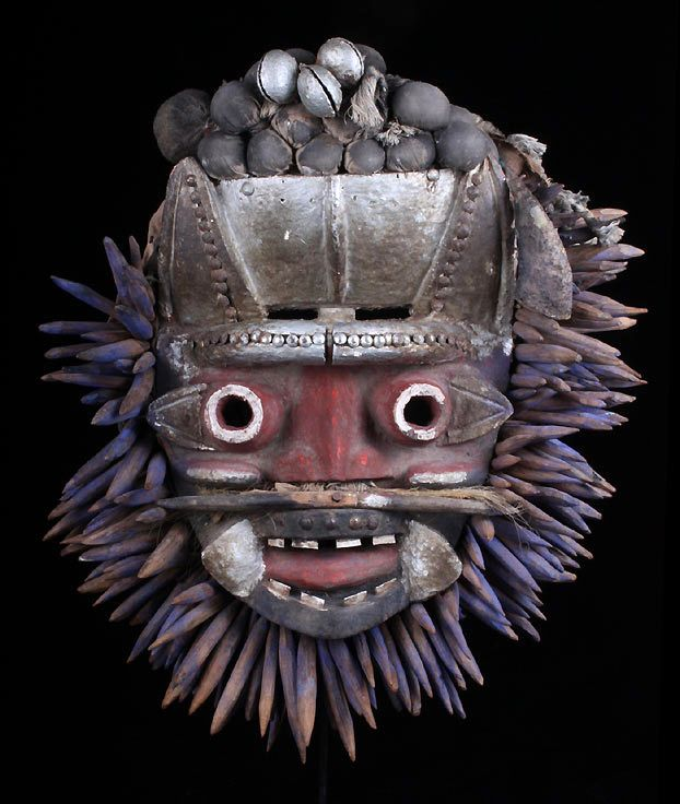 Africa | Guere from the We people of western Ivory Coast | ca. 1940s | Wood, metal, tin, nails, tacks, iron bells, animal hair, animal horn, cloth, natural pigments charcoal, red ocher, blue and trade paint in silver/ aluminum, herbs/ magical substances?