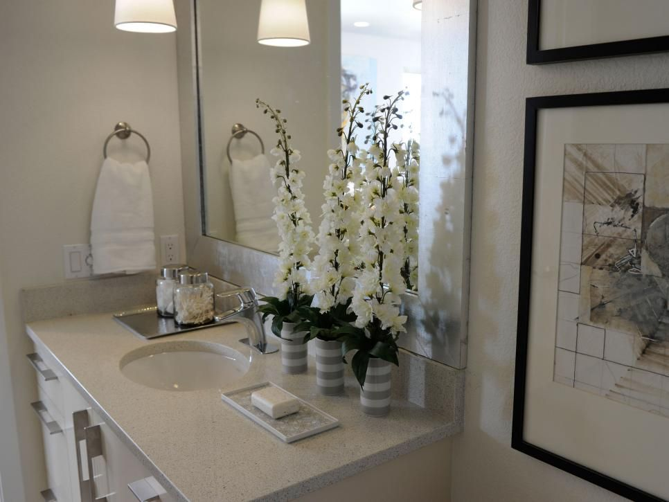 Dazzling White Delphinium Stems Stand Out In This Neutral Hall Bathroom Which Also Features Two Apoth Hall Bathroom Bathroom Pictures Bathroom Decor