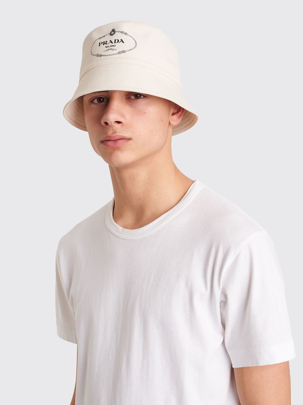 74be085fb65df2 Hat from Prada made of a cotton canvas material with tonal top stitching  and printed heritage logo on the front.