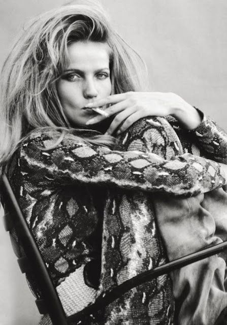 Veruschka wearing a snake print catsuit in the set of Blow Up by Antonioni.