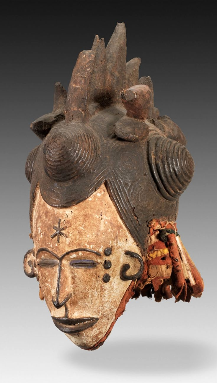 Africa | Maiden spirit mask ~ agbogho mmuo ~ from the Igbo people of Nigeria | Late 19th to early 20th century | Wood, cloth, pigment
