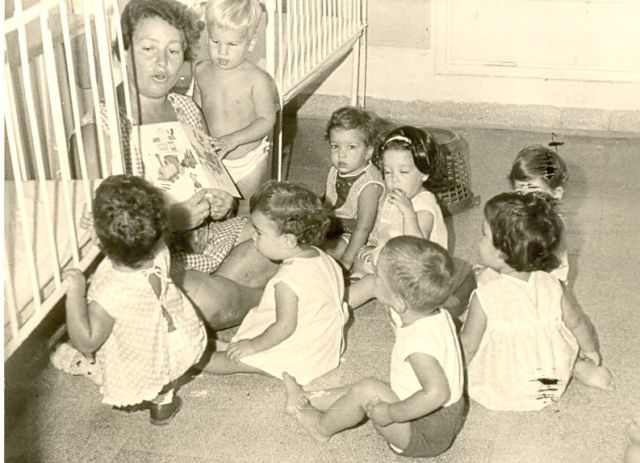 Mid1960s. Metapelet (nanny) with her group of children in a Kibbutz
