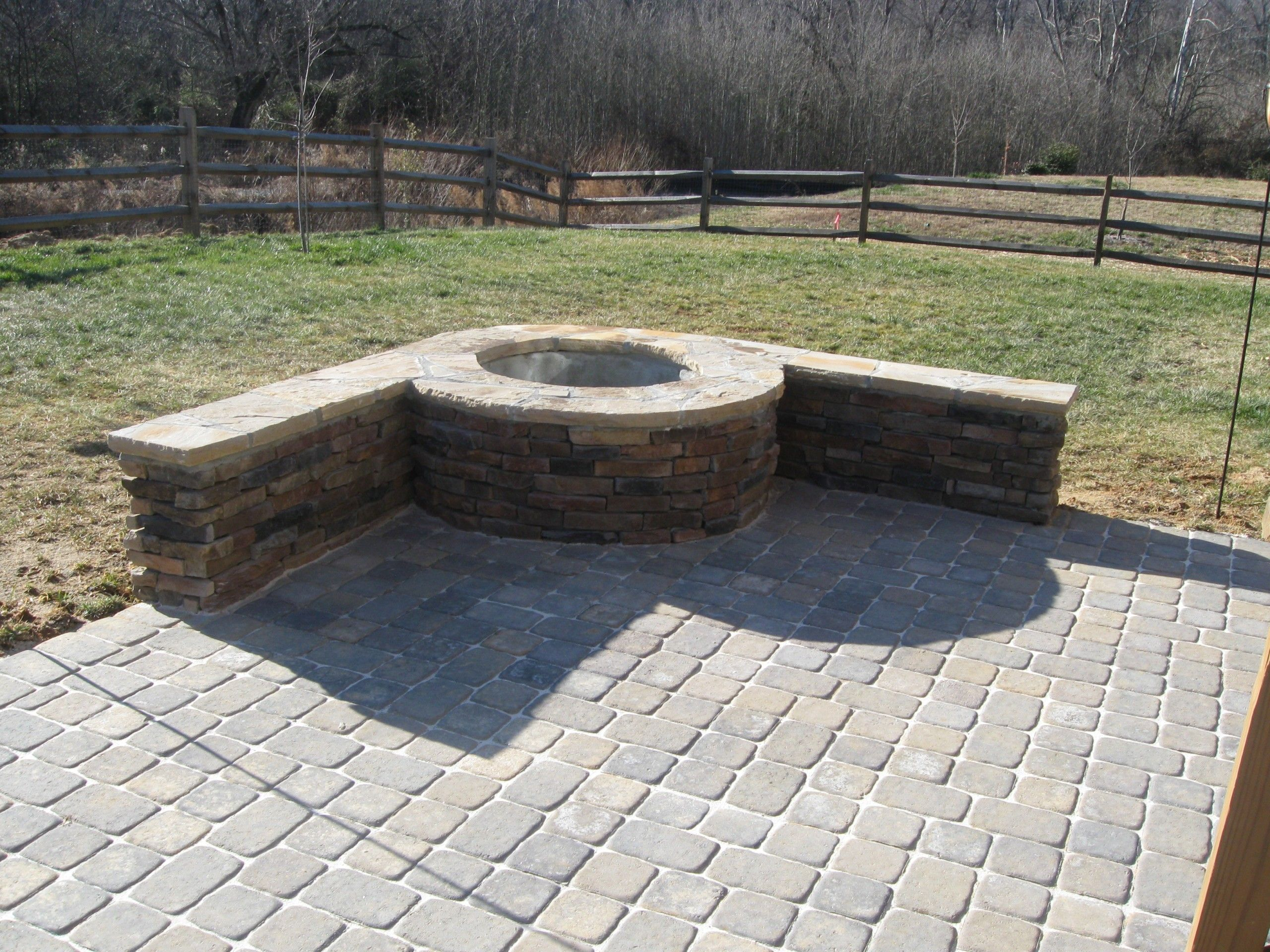 Paver patio with stone firepit in charlotte by archadeck for Pictures of stone patios