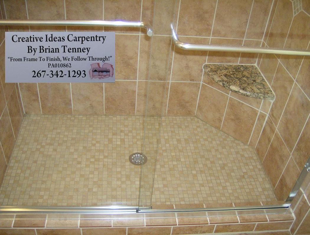 Here You Can See The Tiled Shower Floor And The Corner Seat This