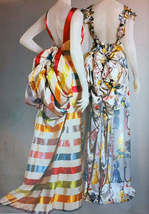 """Elsa Schiaparelli.  Two-Piece evening dresses, Bodice and Skirt Circa summer 1939.  Made from Multicolored silk satin and faille stripe (left).  White silk satin with multicolored """"Mae West"""" figures (right)."""