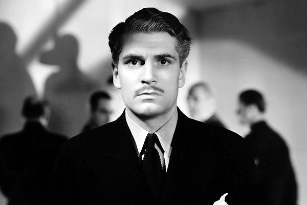 "Laurence Olivier as Maxim de Winter in ""Rebecca"" directed by Alfred Hitchcock and based on the novel written by Daphné du Maurier"