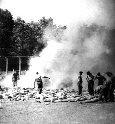 Members of the Sonderkommando burning corpses on fires in pits in 1944. Auschwitz II-Birkenau, photographer unknown.