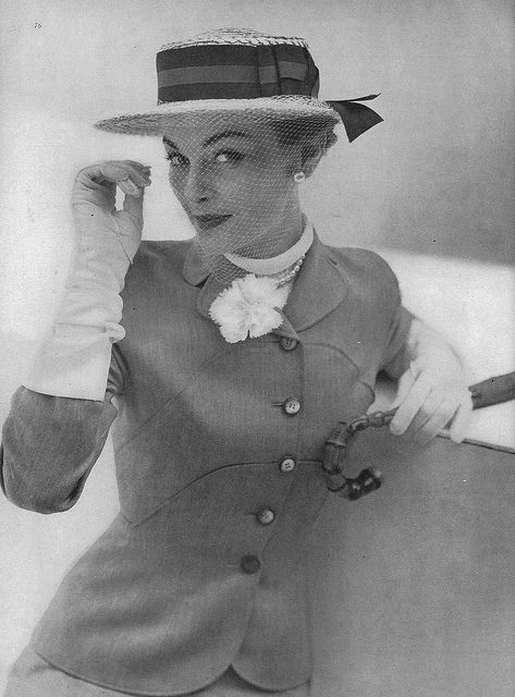 February Vogue 1950    Model is wearing a a grey worsted suit by Swansdown.