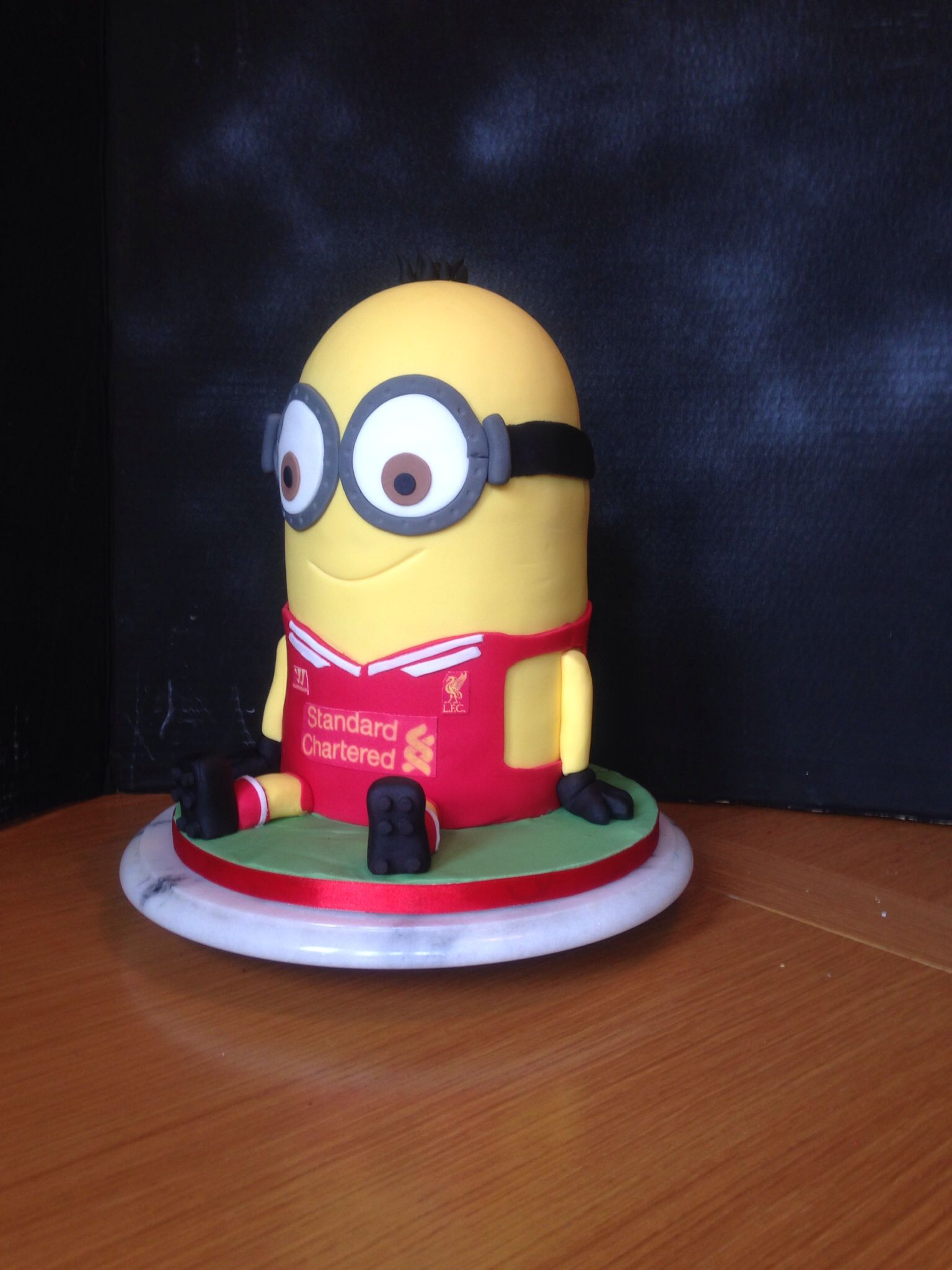 A Liverpool Football Club Minion Cake 14 Inches Tall And