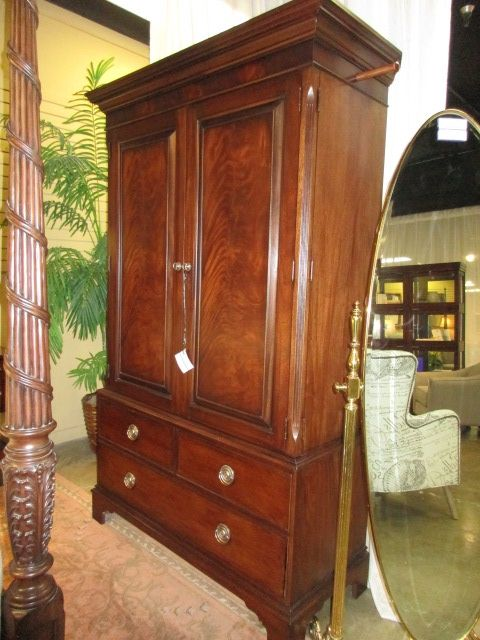 """Handsome Ethan Allen armoire in a medium finish with seven drawers total; four inside and three at the bottom! There is a TV cutout as well as a wardrobe bar for clothing. 53""""W x 22""""D x 83""""H. Matching bed at posting. Arrived: Friday September 2nd, 2016"""