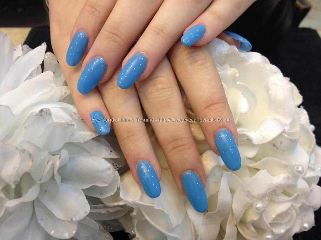 Full set of oval shaped acrylic nails with blue gel polish | Can you ...