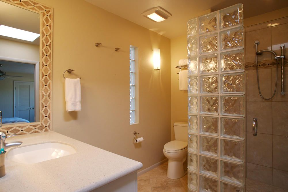 Guest bathroom, partial glass block shower wall and glass block ...